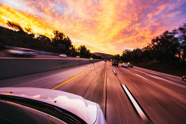 Car driving on the motorway insured by Quote Detective